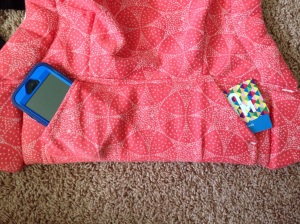 Hoodie-style pouch fits a cell phone, keys and a few other goodies